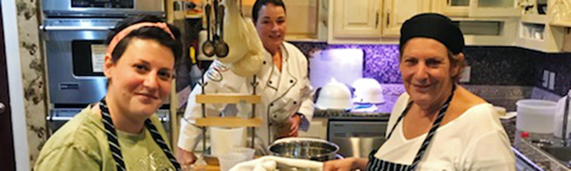 Three Women Making cheese