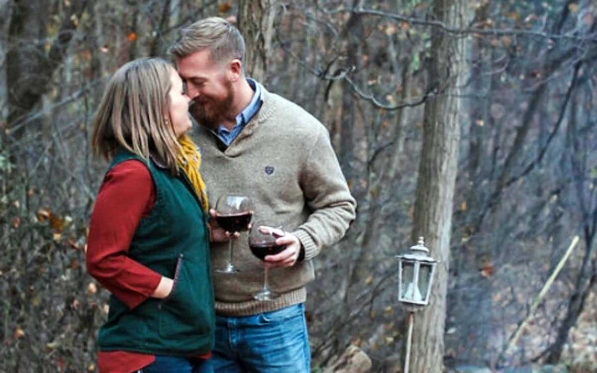 Romantic Couple with Wine in the Woods