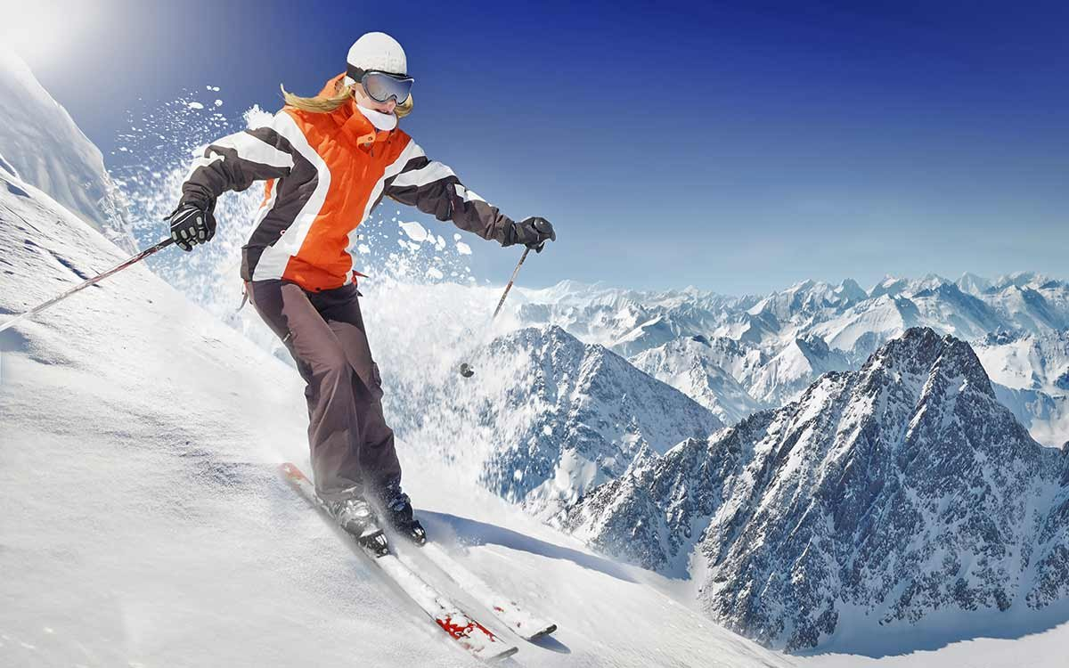 woman snow skiing downhill