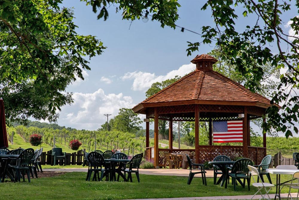 Gazebo Near Chairs and Tables