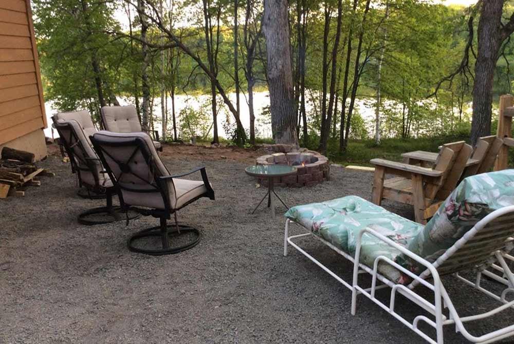 Chairs around Fire Pit Near Lake