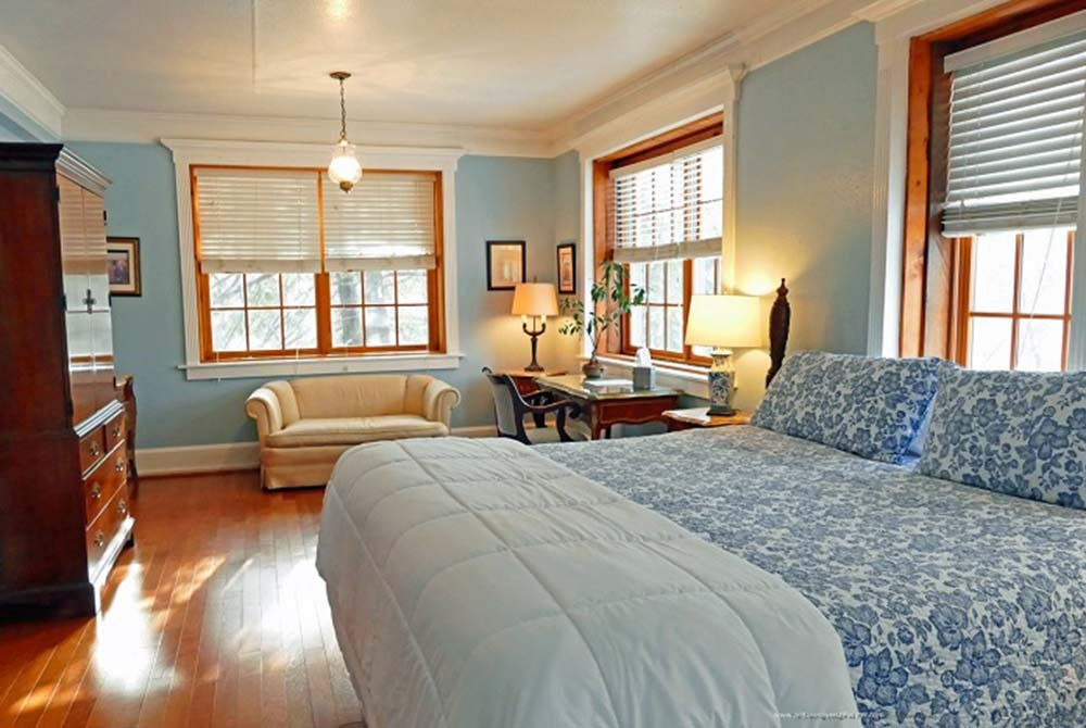 Bedroom with Armoire, Couch, and Bed