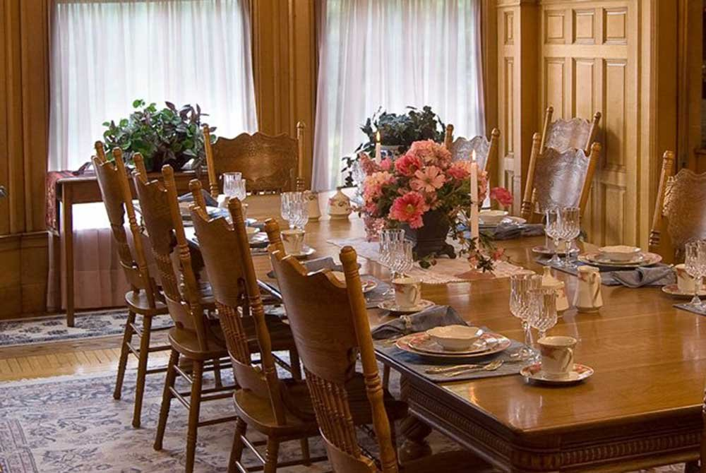 Dining Room Table with Elegant Placesettings