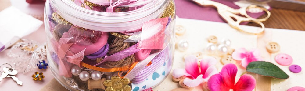 Crafts jar with ribbons and buttons