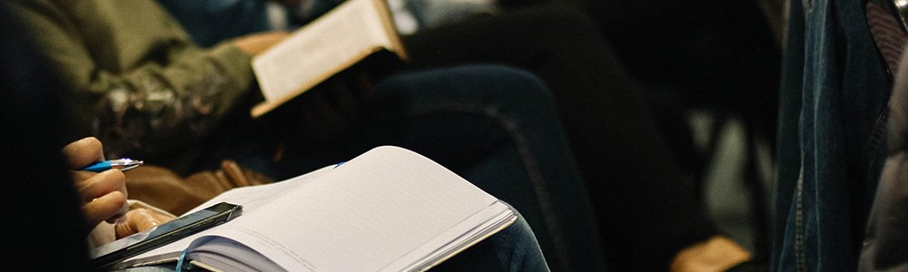 Person taking notes on a notebook