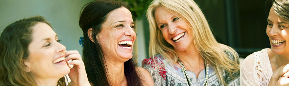 Women smiling and laughing together