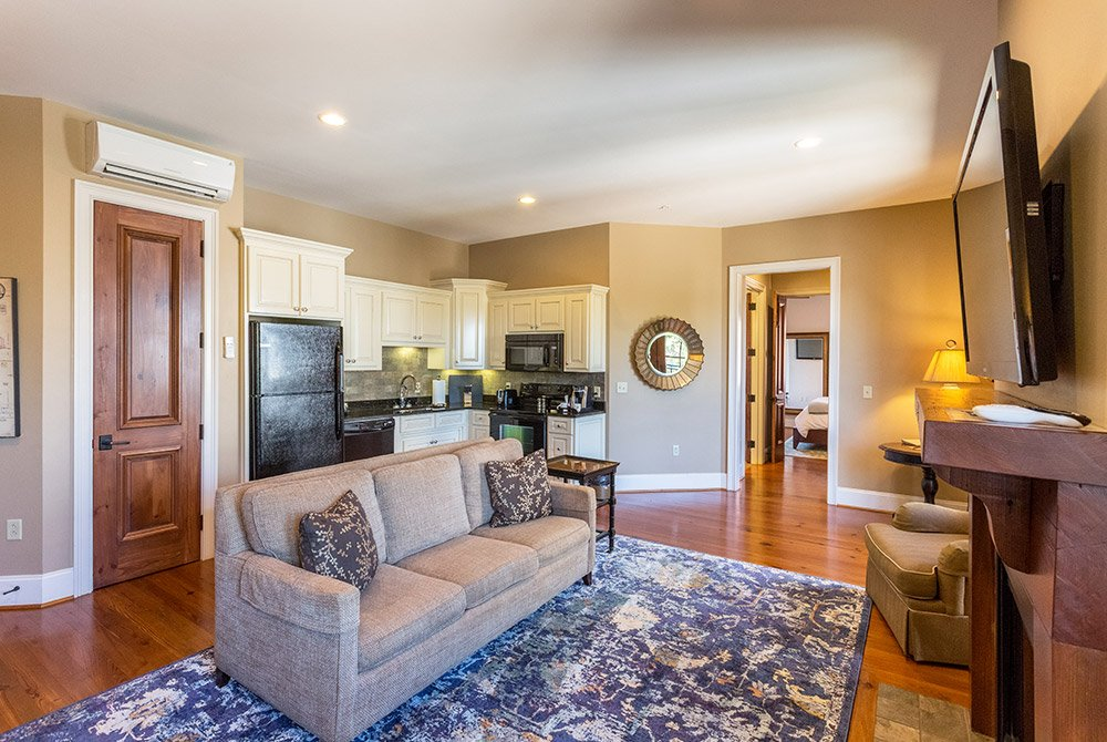Kitchen area behind sofa, fireplace, and television
