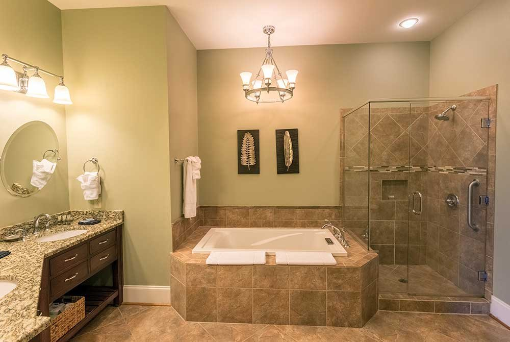 Bathroom with shower, tub, and double sink countertop