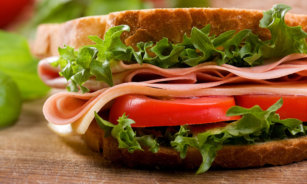 Sandwich with turkey, lettuce, and tomato