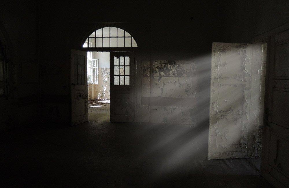 Dark room with open doors