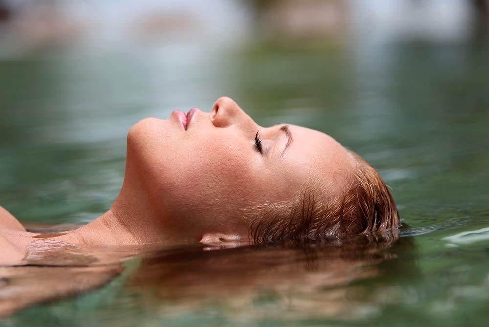 woman relaxing in hot springs