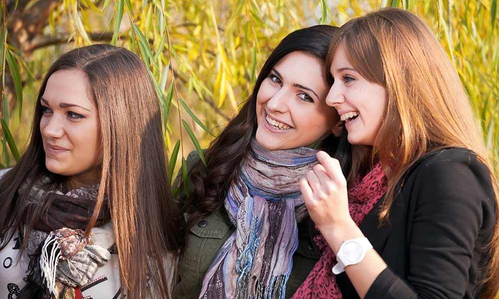 three girls having fun together