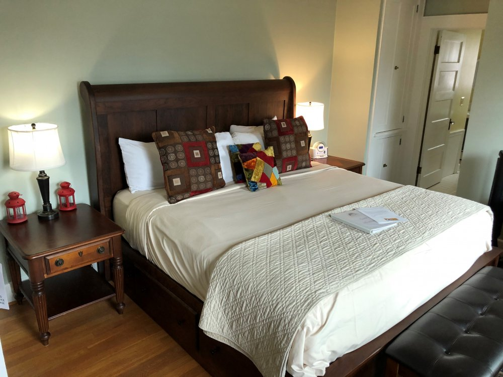 bed with small red lamps on either side, doorway in background