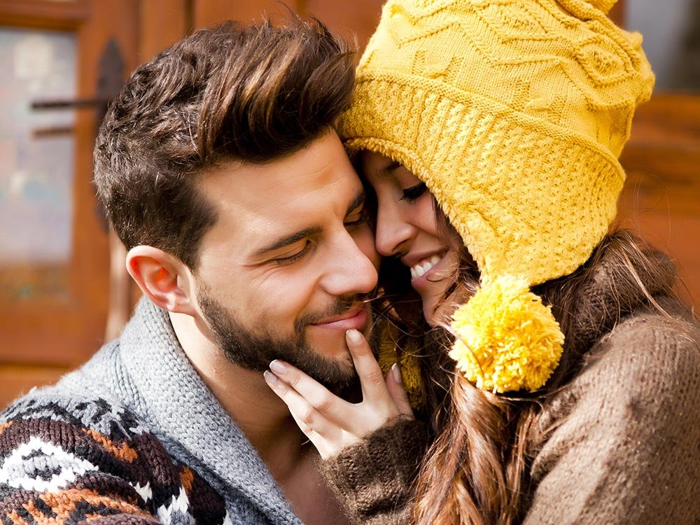 Man and woman cuddling and smiling