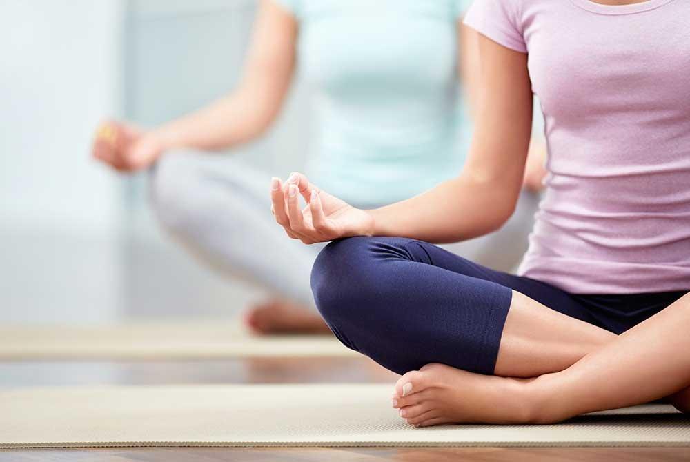 women sitting in a yoga position