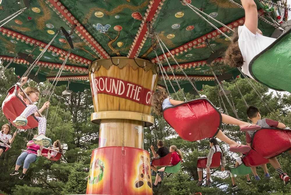 kids on a christmas themed amusement ride