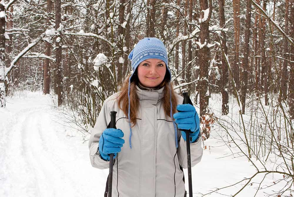 woman holding skiis