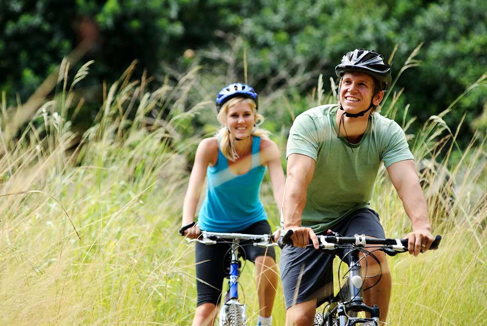 couple riding a bike in nature