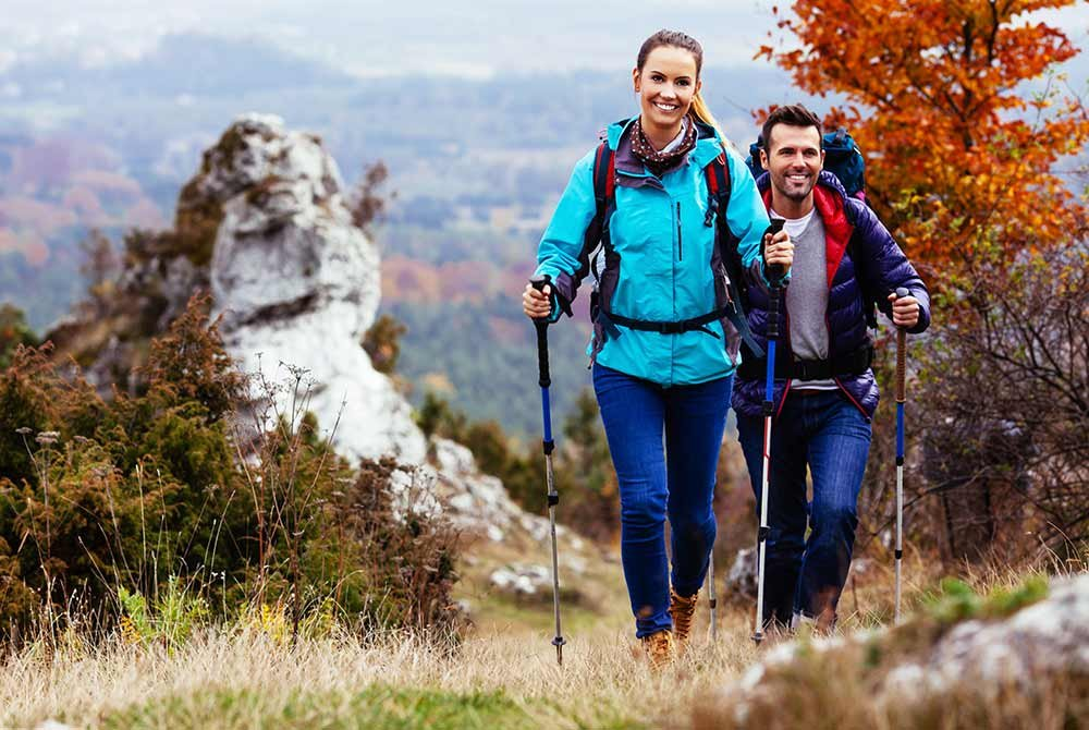 two people hiking up a mountain