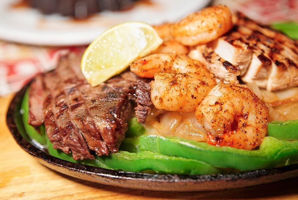 plate of steak and shrimp fajitas