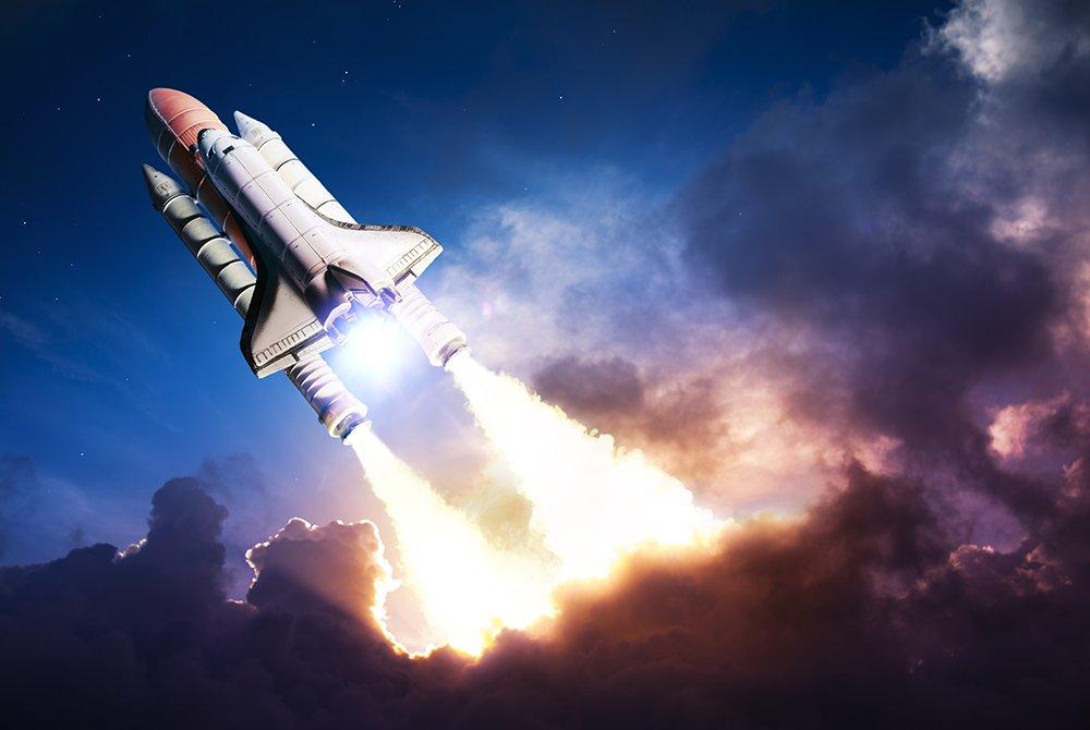 Rocket blasting through clouds